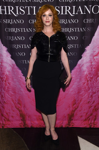 Christina Hendricks slipped into a form-fitting black combo dress by Christian Siriano for the 'Dresses to Dream About' book release.