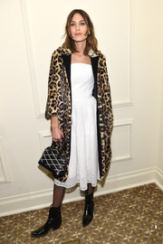 Underneath her coat, Alexa Chung was ladylike in a strapless LWD.