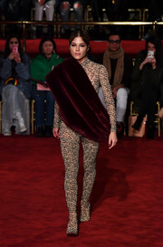A burgundy fur stole added a touch of glamour.