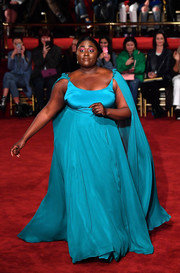 Danielle Brooks wowed in a caped turquoise gown while walking the Christian Siriano runway.