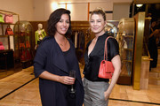 Ellen Pompeo attended the Christie's x What Goes Around Comes Around 25th anniversary auction preview carrying a chic orange bag by Chanel.
