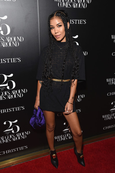 For a pop of color, Jhene Aiko accessorized with a purple satin purse.