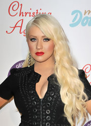 Christina Aguilera looked fierce and sexy in a little black dress that she paired with retro red lips.