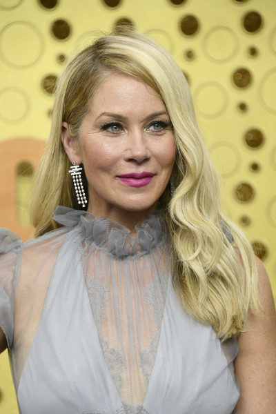 Christina Applegate Long Wavy Cut [hair,blond,face,hairstyle,lip,beauty,eyebrow,lady,chin,long hair,arrivals,christina applegate,emmy awards,microsoft theater,los angeles,california]