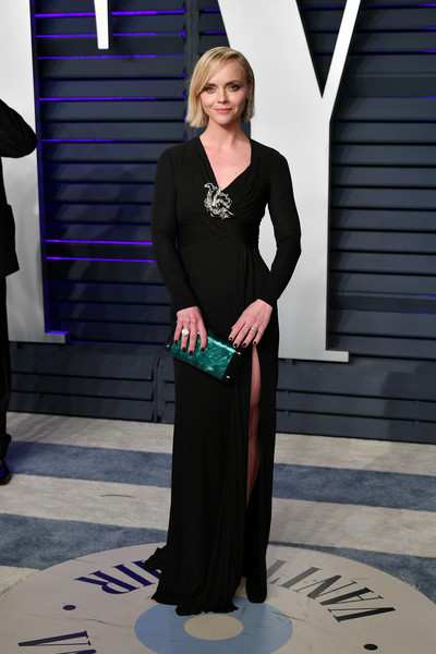 Christina Ricci Hard Case Clutch [oscar party,vanity fair,clothing,fashion,formal wear,dress,neck,fashion design,sleeve,event,haute couture,style,california,beverly hills,wallis annenberg center for the performing arts,radhika jones - arrivals,radhika jones,christina ricci]