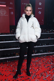 Lily-Rose Depp completed her cold-weather look with a pair of black mid-calf boots by Chanel.