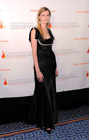 Alexandra dons a satin floor length gown with jeweled embellishments.