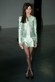 Caroline Sieber accessorized her mint green ensemble with classic black platform pumps.
