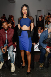 Keke Palmer coordinated her top with a blue and black pencil skirt.