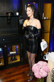 Bella Hadid amped up the edgy vibe with a pair of studded Louboutins.