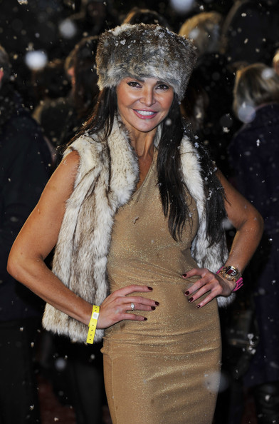 Lizzie Cundy paired her floor length gown and fur accessories with a large pink watch.