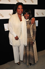 Oprah Winfrey added flair to her all-white ensemble with a fringed white scarf when she attended the unveiling of the Cicely L. Tyson Community School of Performing and Fine Arts.