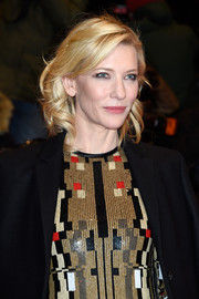 Cate Blanchett styled her blonde locks with sweet waves and side-swept bangs for the BIFF premiere of 'Cinderella.'