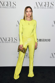 Delilah Belle Hamlin punctuated her yellow look with a gold box clutch.