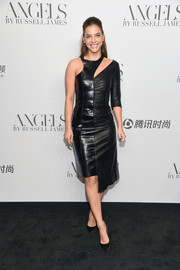 Barbara Palvin was rocker-glam in an asymmetrical black leather dress by Off-White at the 'Angels' by Russell James book launch.