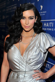 Kim Kardashian attended the Cinema for Peace Benefit wearing a pale peach polish on her short squared nails.