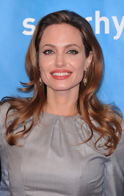 Angelina Jolie wore her hair in long glossy waves at the 2012 Cinema for Peace Gala.