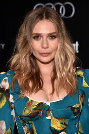 Elizabeth Olsen looked glam with her piecey, center-parted waves at a screening of 'Captain America: Civil War.'