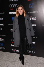 Olivia Palermo teamed a black Iris Von Arnim turtleneck with leather pants and a gray coat for the screening of 'Captain America: Civil War.'