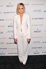 A crisp white pantsuit gave Maika Monroe a totally cool and sexy look at the 'At Any Price' screening in NYC.