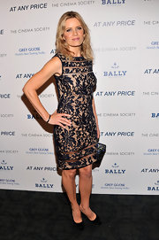 Kim Dickens showed off her fit figure with this nude and black brocade dress.