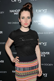 Zoe Lister Jones pulled her hair up in a high bun that was pinned into place at the crown.
