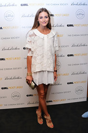 Olivia Palermo kept her look soft and romantic with a sheer lace blouse that featured a wide Peter Pan collar.