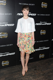 A pair of nude peep-toes with gold platforms tied Sami Gayle's look together.