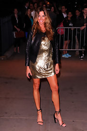 Kelly Bensimon stepped into a pair of black strappy sandals for a screening of 'The Hunger Games.'