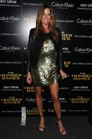 Kelly Bensimon glittered in this gold sequined dress and leather jacket at the NY screening of 'The Hunger Games.'
