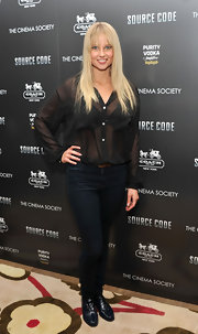 Genevieve Morton teamed her monochromatic premiere look with black flat brogues.