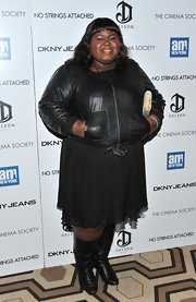 Gabourey donned a sleek leather jacket over a cocktail dress for the 'No Strings Attached' premiere.
