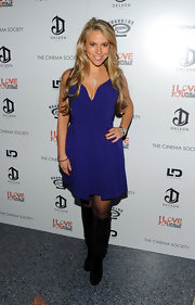 Brooke Milstein donned suede knee high boots with a blue cocktail dress. Long wavy locks complete the evening look.