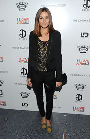 Olivia dons a sleek tuxedo blazer of a lace blouse for the screening of 'I Love You Phillip Morris.'