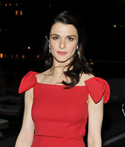 Rachel Weisz paired her bright red Valentino dress with elegant diamond jewelry and gorgeous windswept curls.