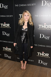 AnnaSophia Robb added shine and elegance via a pair of pointy gold Stuart Weitzman pumps.