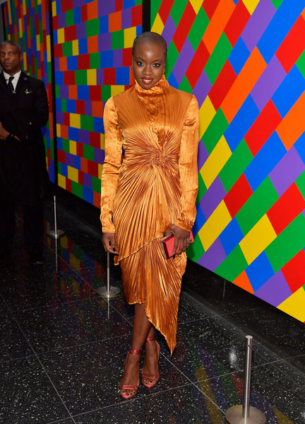 Danai Gurira went for a bold color combo, pairing strappy pink Jimmy Choo sandals with her marigold separates.