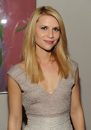 Claire Danes went the sleek route while at the Cinema Society event. She paired her cocktail dress with a sleek shoulder length hairdo.