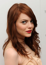"Emma Stone showed off her fiery red locks at the screening of ""Paper Man"". She spiced up her look with a touch of blazing red lipstick."