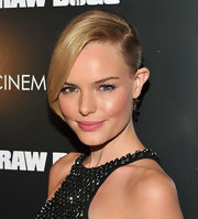 At a screening of 'Straw Dogs', Kate Bosworth wore a sleek and sexy updo. To try her look, make a deep side part and section out bangs. Next, pull hair back into a low pony tail, twist and pin into place. Bangs can then be swept across forehead and spritzed with a medium-hold hairspray.