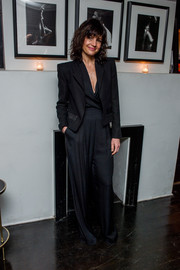 Carla Gugino teamed a cropped jacket with a charcoal jumpsuit for the premiere of 'Sky.'