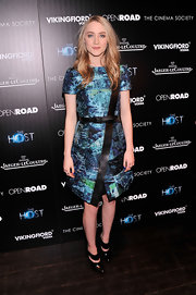 Saoirse Ronan chose a watercolor tweed jacquard dress with leather trim for her sleek and modern red carpet look.