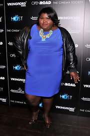 Gabourey Sidibe chose a classic leather jacket to pair with her feminine cocktail dress for a fun and modern ensemble.