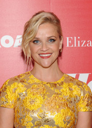 Reese Witherspoon looked glam wearing this loose bun with wavy tendrils at a screening of 'Home Again.'