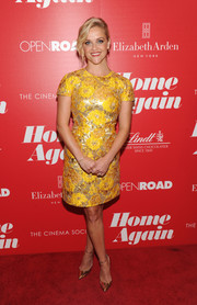 Reese Witherspoon finished off her bright ensemble with gold ankle-strap pumps by Jimmy Choo.