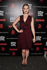 Bella Heathcote carried a bronze Kotur minaudière at the 'Killing Them Softly' premiere.