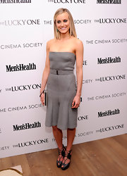 Tyalor Schilling's charcoal strapless dress is so chic it kills.