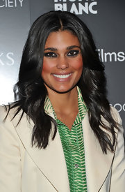 Rachel Roy added a smoldering touch to her look with kohl rimmed eyes. High-impact mascara and a flushed cheek finished off her look.
