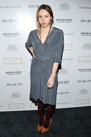This languid gray silk dress was spruced up with a pair of maroon tights and burnt orange pumps.