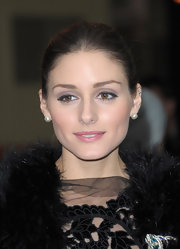 To get Olivia Palermo's jeweled-toned look, try Lancome Color Design Eye Brightening All-in-One Shadow & Liner Palette in Amethyst Glam. The purple rose shadow can be swept over the entire lid while grape gray shimmer is blended into creases and lavender white shimmer is used to highlight brow bones.